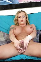 Beautiful blonde shemale plays with huge cock