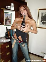 Shemale Brunette With Big Tits Poses In Jeans