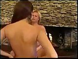 Tranny and girl fucking by the fireplace