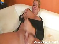 Titty shemale shows her huge tits