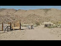 LEATHER BIKER SHEMALE IN NEVADA DESERT WITH BUTTPLUG