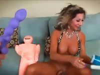 Busty shemale jerks off into dolls mouth