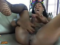 Black tranny toying ass with dildo