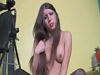 Longhaired tranny pleases herself