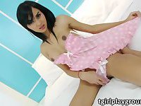 Beautiful Asian TS Aor stripes and masturbates her girl boner
