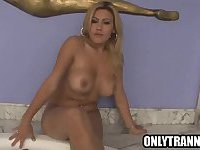 Shemale Ellen Silva tugging on her cock in a hot tub
