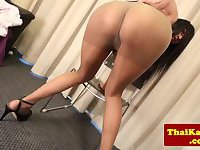 Asian shemale doctor with glasses strips sensually
