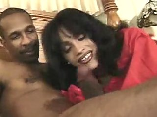 Ebony guy has fun with brunette tranny