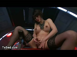 Tranny jerks off cock in front of bound guy
