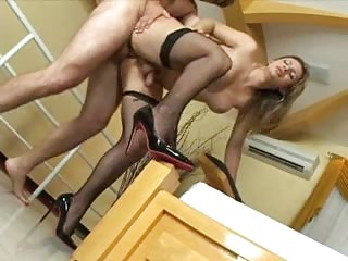 Stud fucks shemale in stockings in doggy style