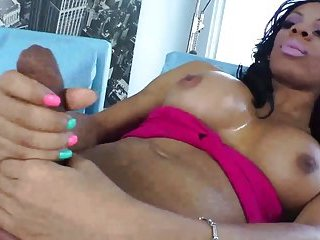 Black shemale tugging her cock