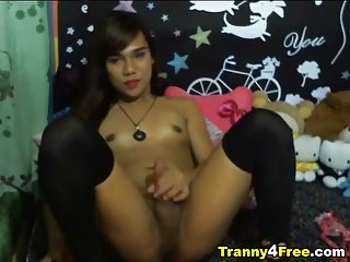 Cute Tranny Spreads her Legs and Strokes her Cock