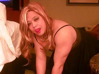Asian crossdresser in a hotel