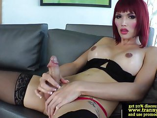 Classy transsexual feels her cock grow bigger in her hands