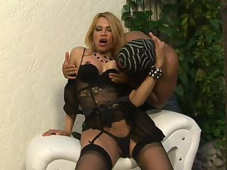 Tranny in black spreads her legs