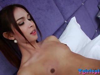 Two Thai ladyboys anal threesome action